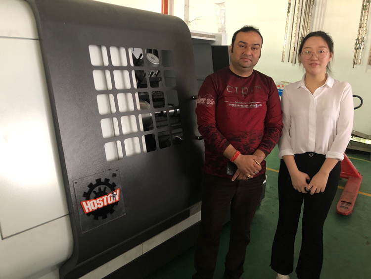 Indian customer came to the factory to inspect the CNC metal spinning machine which is ready to be delivered.